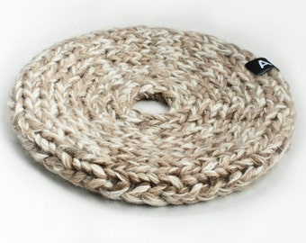 Knitted trivet and table decoration, beige mix
