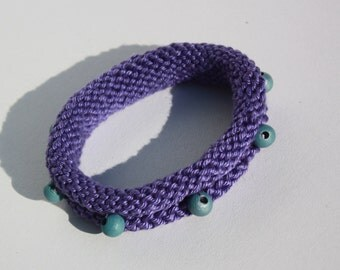purple knitted bracelet with beads