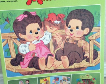 UNCUT Monchhichi paper doll book by Golden