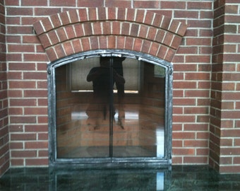 Arched Full View Fireplace Doors.