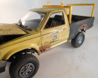 1980 Toyota 4x4 1/20 scale model truck in yellow