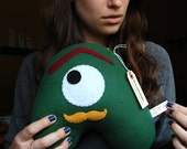 Marshal Mustard iloveyoumonster - green medium plushie with gold mustache and maroon eyebrow
