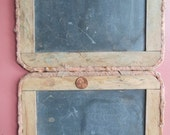 Primitive double bound slate chalkboard with charming historical character.