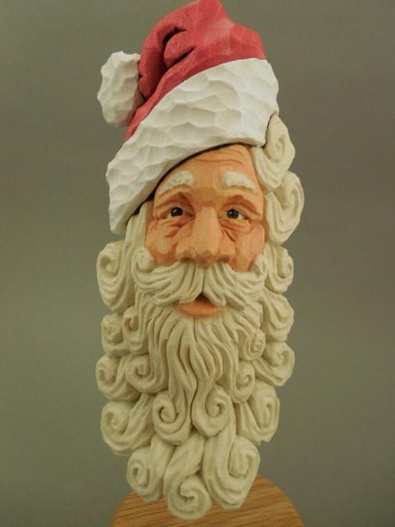 Detailed hand carved wood santa ornament