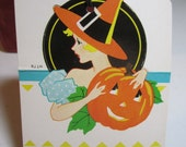 1930's-40's unused art deco die cut halloween bridge tally card profile of pretty lady in witches hat holding an adoring Jack o ' Lantern