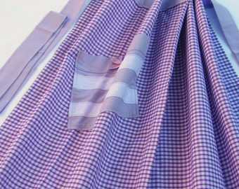 Apron in purple gingham. Half apron with pocket detail.