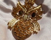 Gold articulated owl necklace