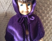 Purple hooded cape with pink sparkles.