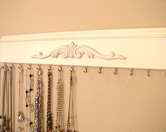 "neckace organizer This economical jewelry rack is a great choice for hanging individual necklaces.Off white shbby chic w/ 15 hooks 20"" longj"