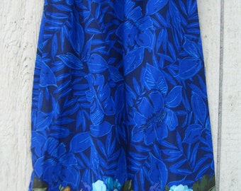 Dark blue skirt with large flowers arount the bottom.