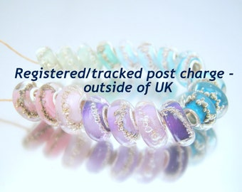 Registered/tracked post charge outside of UK