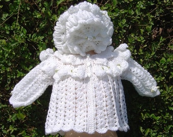Traditionally styled white frilly crochet baby jacket with matching bonnet