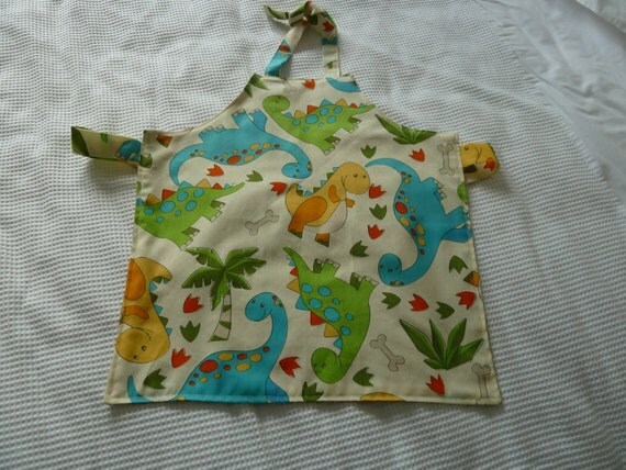 Childrens fabric apron cute dinosaur print by prettypastels for Kids dinosaur fabric