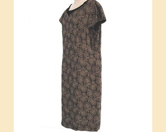 Vintage 1960s tunic dress in gold and black brocade with velvet trimmed neckline and short sleeves