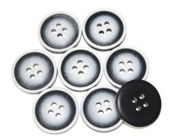 15 PCS of Plastic Black and White Buttons for Sewing, Fashion and Accessories.