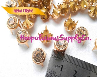 25pc 10mm Gold Prong Studs w/Silver Rhinestone Center. Perfect 4 Leather. Shoes. Shirts. Shorts. Customize your clothing.Ships from USA.