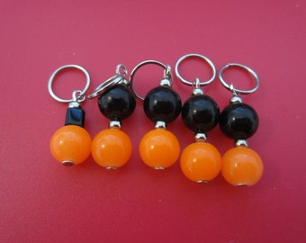 A set of 5 acrylic orange and black bead stitch markers for knitting - fits needles up to size 4.00 mm