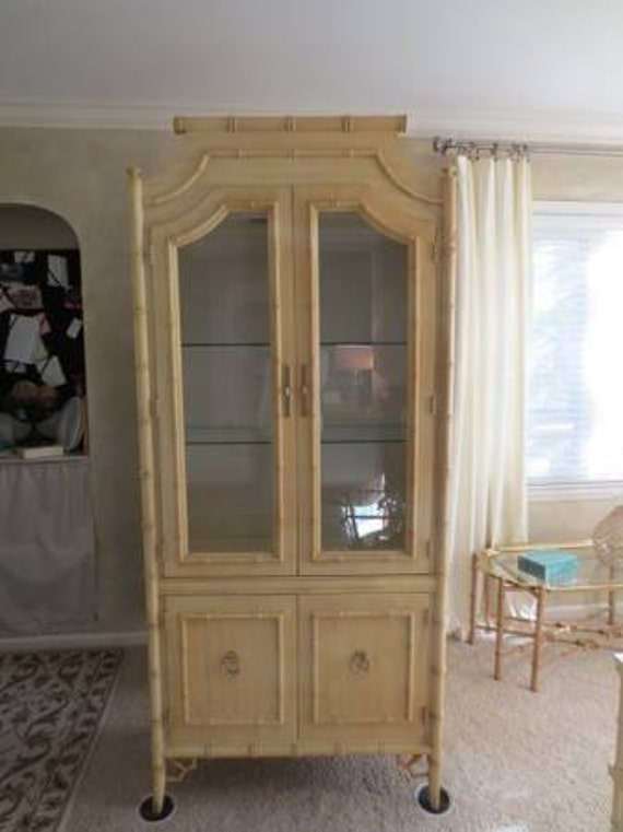 hold for Jenna-Thomasville faux bamboo china cabinet/hutch