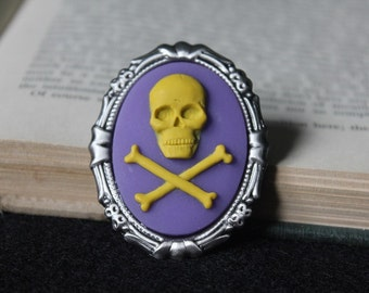 Yellow On Purple Skull And Crossbones Silhouette Cameo Brooch