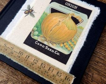 Allotment gardener's handprinted seed packet notebook journal