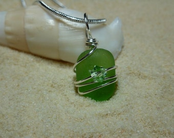 Tiny wire wrapped lime green sea glass necklace with Swarovski crystal bead and sterling silver chain