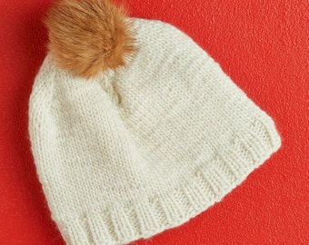 hand-knitted beanie with fox pompom, wool