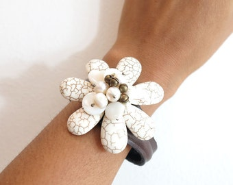 White howlite flower on leather cuff.
