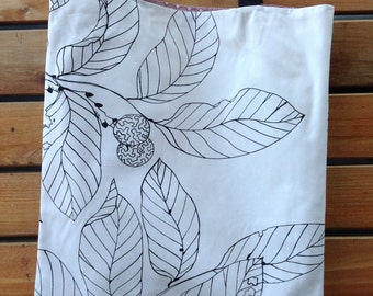 Handmade white canvas tote bag with leaf print, fully lined