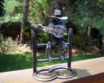Horseshoe art cowboy with guitar.
