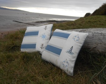 Push the boat out.....embroidered nautical cushions..