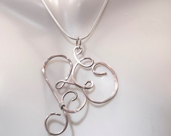 Your initials in sterling silver
