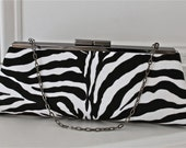 Modern clutch in black and white zebra print/ animal print with strap.