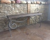 Scroll iron bench with distressed pine seat