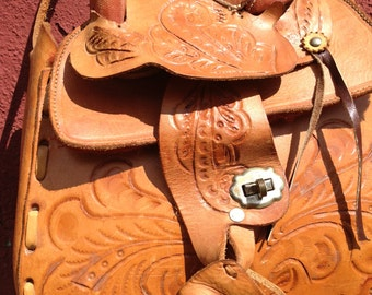 Vintage Mexican leather tooled handbag  with saddle