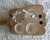 Four Open Glass Salt Cellars and a Silver Salt Spoon
