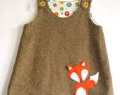 Woodland fall woolen baby girl dress with felt fox detail.