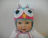 Baby Crochet Owl Hat in Hot Pink and Blue with warm ear flaps.  Soft Acrylic Yarn and large button eyes.  Ties under chin.