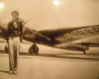 Amelia Earhart with her Lockhead Electra airplane before she disappeared, July 1937