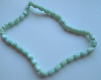 Strand of Light Green Oval Cats Eye Beads, apprx 10x5 mm