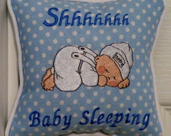 Baby sleeping pillow has a precious baby digitized on the front with the wording, shhhhhh baby sleeping.