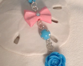 Blue Flower with a Pink bow cell phone charm, dust plug charm, phone charm, iphone charm, ipad charm, headphone jack plug charm, plug charm.