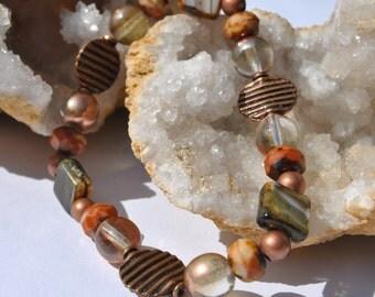 Warm orange color Czech glass beads and copper accents stretch bracelet set