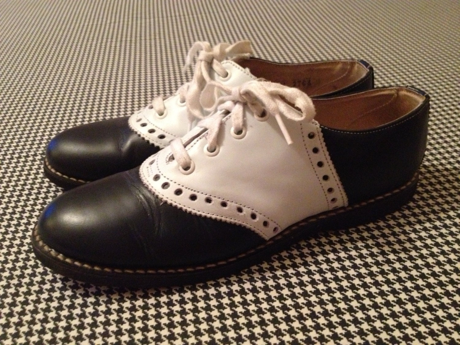 s navy blue and white saddle shoes with black