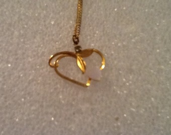 Very nice gold tone vintage heart necklace with small mother of pearl heart and rhinestone