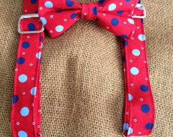 Red with blue dots suspenders and bow tie.