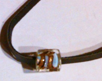 Leather braclet with square tiger stripe charm bead