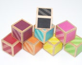 Set of eight wooden blocks with two brightly colored patterns stripes and solids