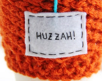 Huzzah Personalized Travel Mug Cozy, Knit Mug Cozy, Knitted Cup Sleeve, Orange Coffee Mug Cozy, Quote Mug, Personalized Mug Cozy