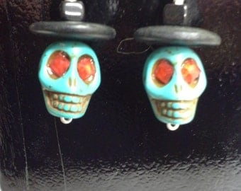 Skeleton earrings in turquoise with red eyes and a black hat