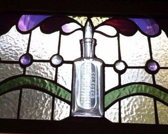 Hand made window panel with antique bottle